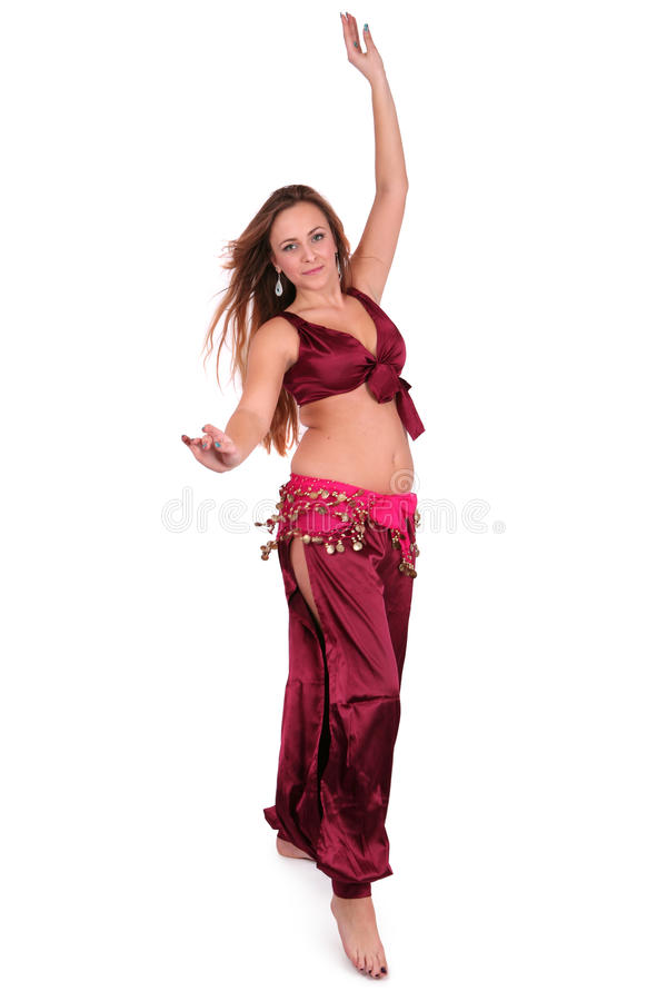 Beautiful young belly dancer in red costume stock images