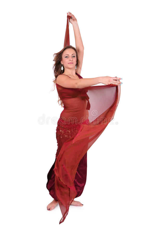 Beautiful young belly dancer with a veil royalty free stock photos