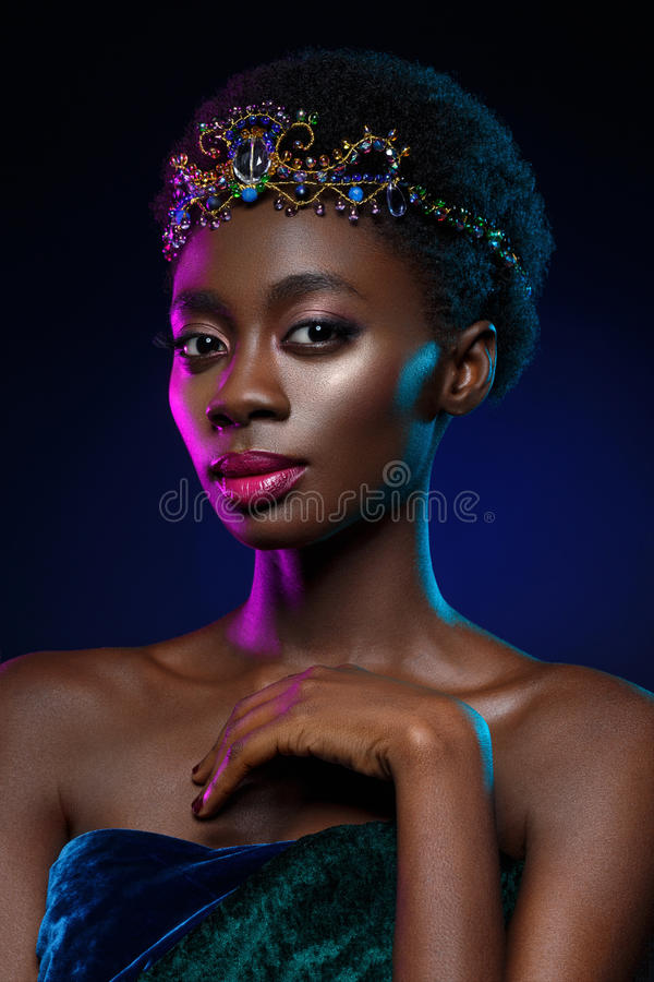 Beautiful black girl with crystal crown stock photo