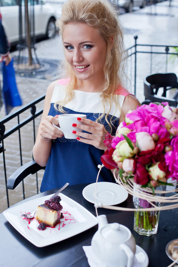 A Beautiful Young Blond Girl In Summer Dress At The Table In Pav Royalty Free Stock Images