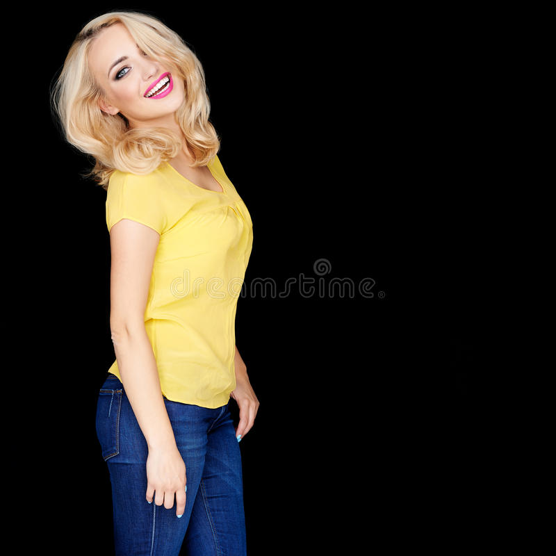 Beautiful young blond woman with a beaming smile royalty free stock images