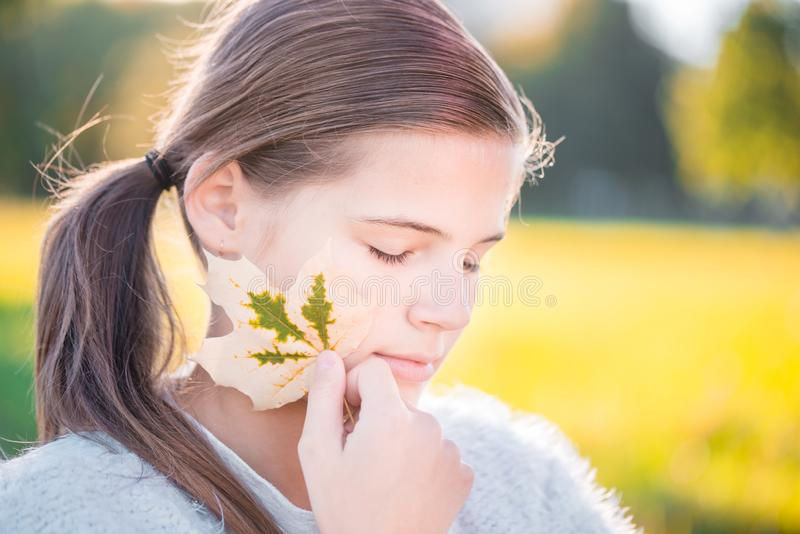 Beautiful young blond woman - colorful autumn portrait royalty free stock photo