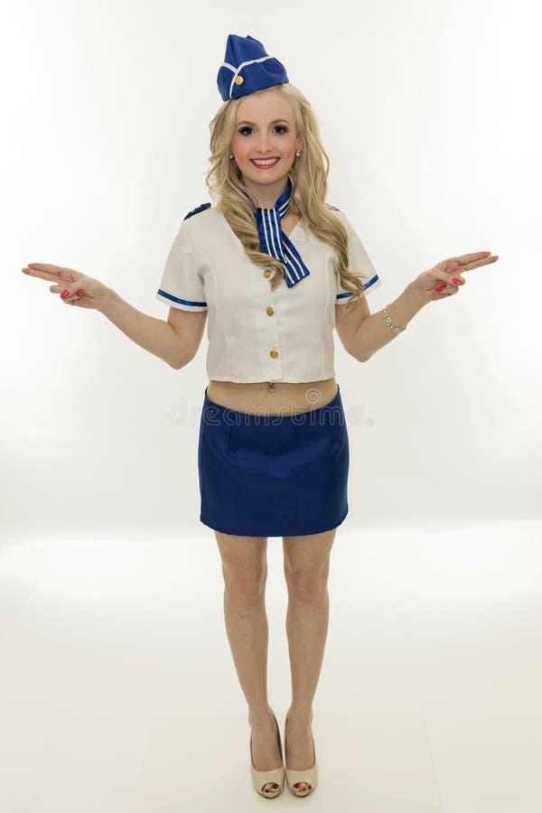 Beautiful young blond woman flight attendant royalty free stock photo