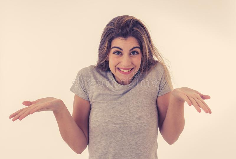 Happy young attractive woman shocked with a surprised funny face. Human expressions and emotions. Beautiful young blond woman with happy face pointing and making royalty free stock photography