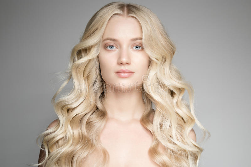 Beautiful Young Blond Woman With Long Wavy Hair. stock image
