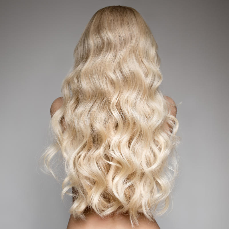 Beautiful Young Blond Woman With Long Wavy Hair. stock photography