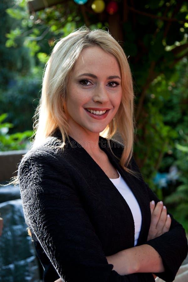 Beautiful young blond woman outdoors stock photos