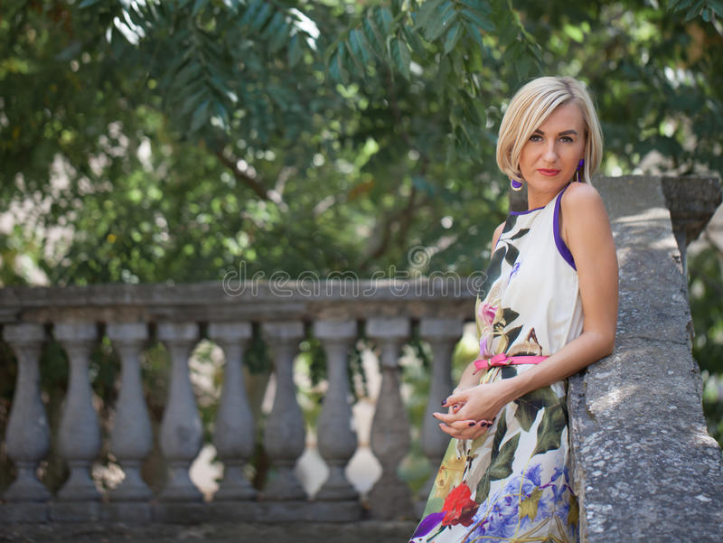 Beautiful young blond woman outdoors royalty free stock photo