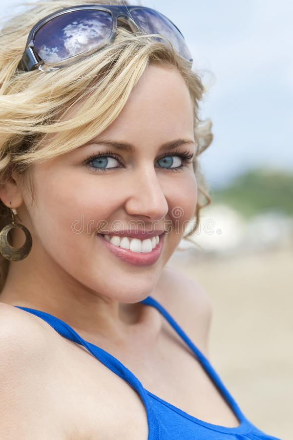 Download Beautiful Young Blond Woman Smiling At The Beach Stock Image - Image: 12696203