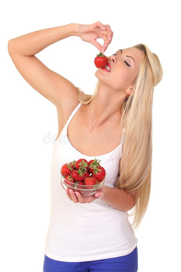 Beautiful young blond woman with strawberry royalty free stock photos