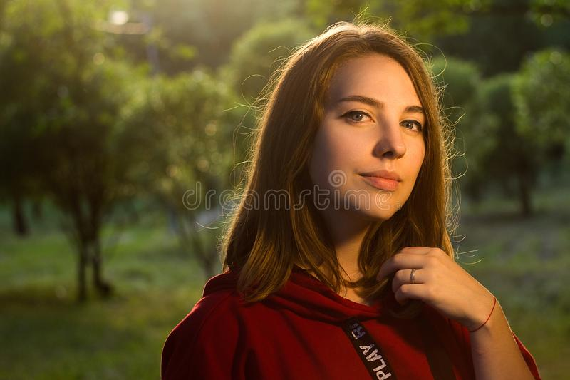 Blonde girl in red sweatshirt smiling royalty free stock photo