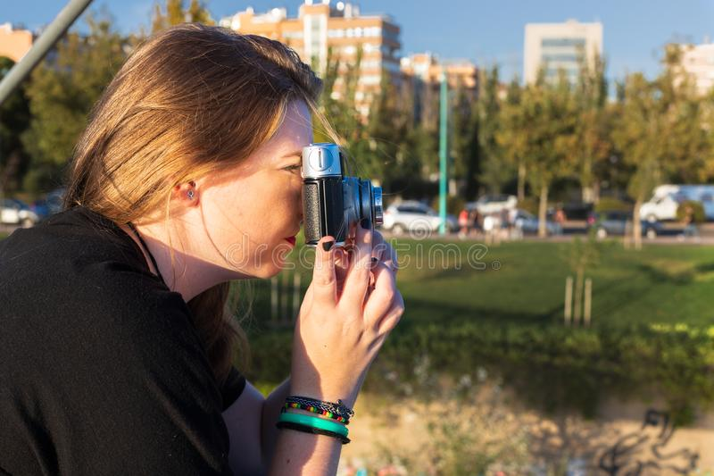 Young blonde girl taking pictures stock photos