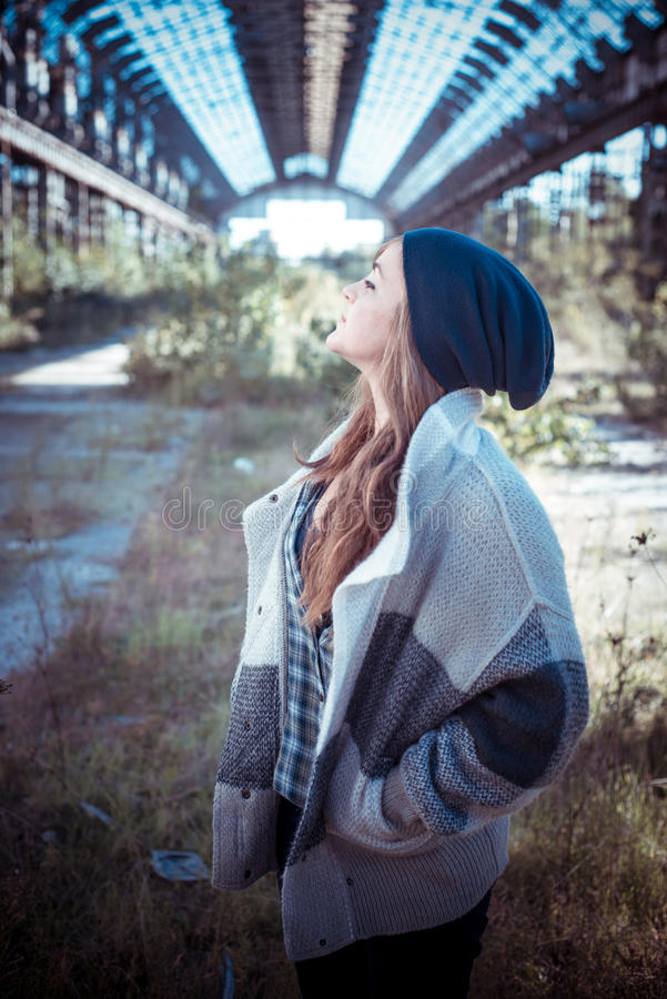 Beautiful young blonde hipster stylish woman royalty free stock photo