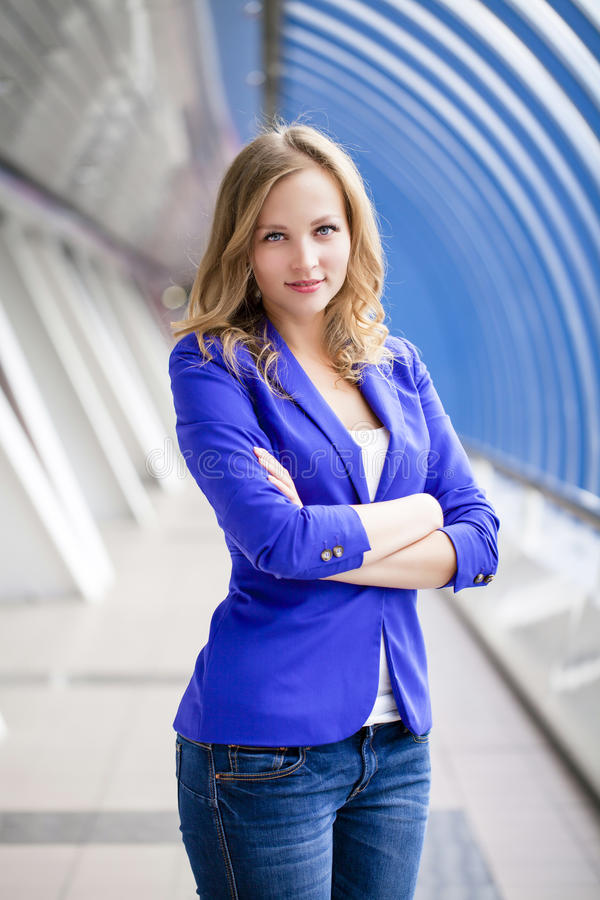 Free Beautiful Young Blonde In A Blue Jacket Royalty Free Stock Photography - 45888477
