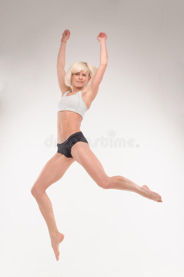 Beautiful young blonde in a jump stock photo