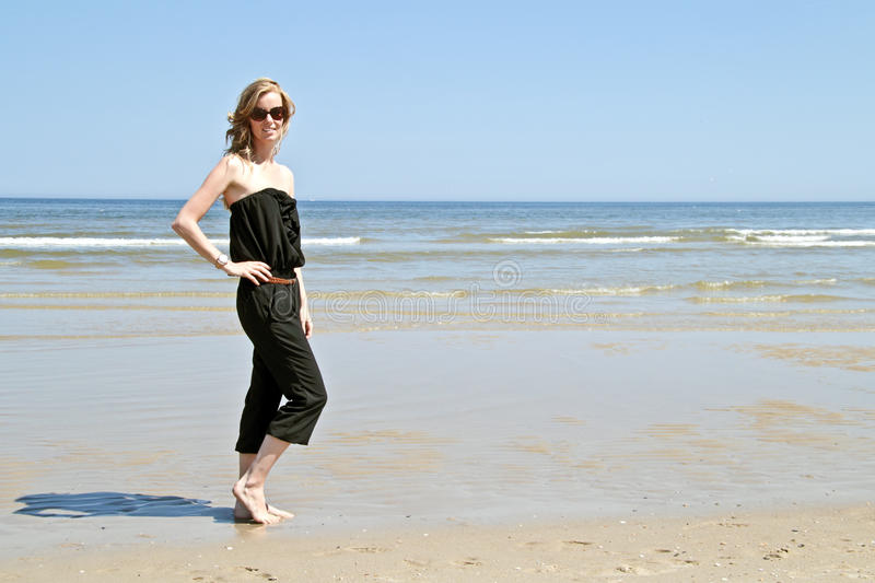 Beautiful young blonde woman at the beach stock photos