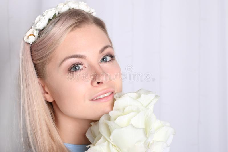 Beautiful young blonde woman with clean skin and flower stock images