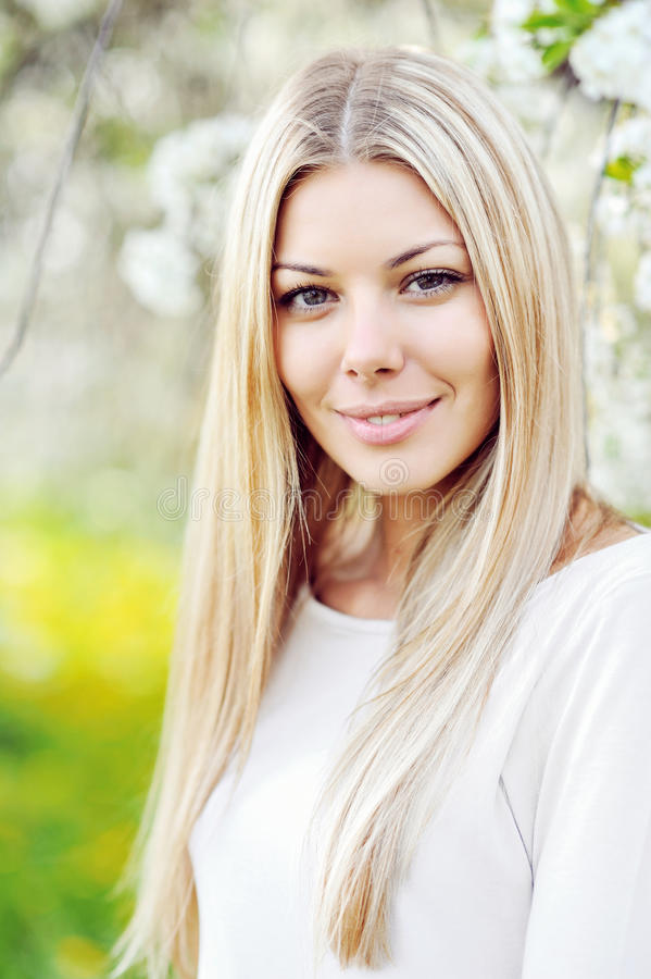 Beautiful young blonde woman face close up stock photography