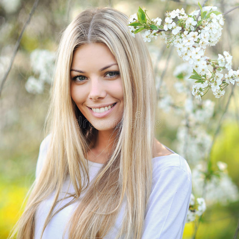 Beautiful young blonde woman face - close up stock photo