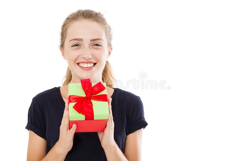 Beautiful young blonde woman holding gift over isolated background with surprise face pointing finger to himself,copy space.  stock photo