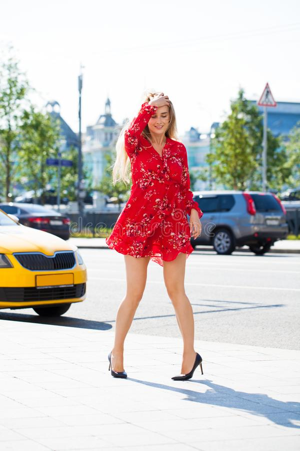 Beautiful young blonde woman in red dress stock images