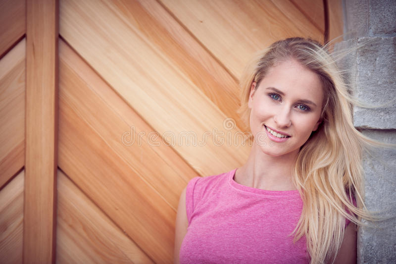 Beautiful young blonde woman on a walk arownd the city near to the castle in summer sunny day stock photo