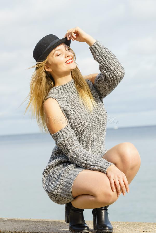 Woman wearing fedora and jumper outdoor stock image