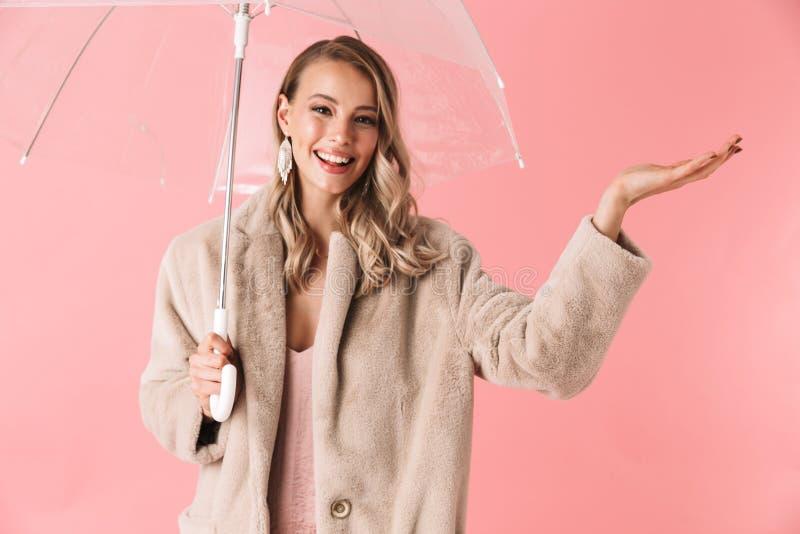 Beautiful young blonde woman wearing winter fur coat royalty free stock image