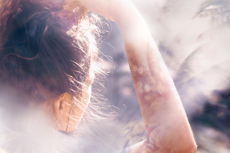 Beautiful young boho woman portrait outdoors at sunset royalty free stock image