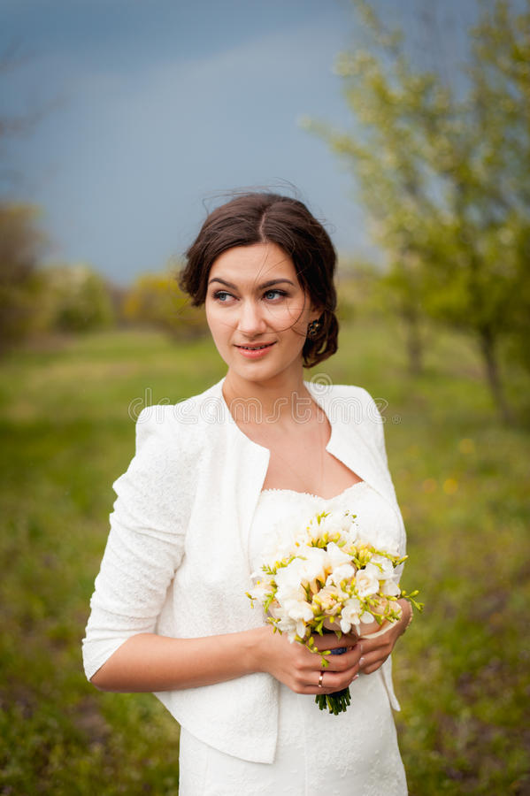 Beautiful young bride in luxury wedding dress stock photography