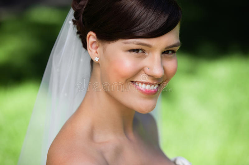 Beautiful young bride smiling royalty free stock image
