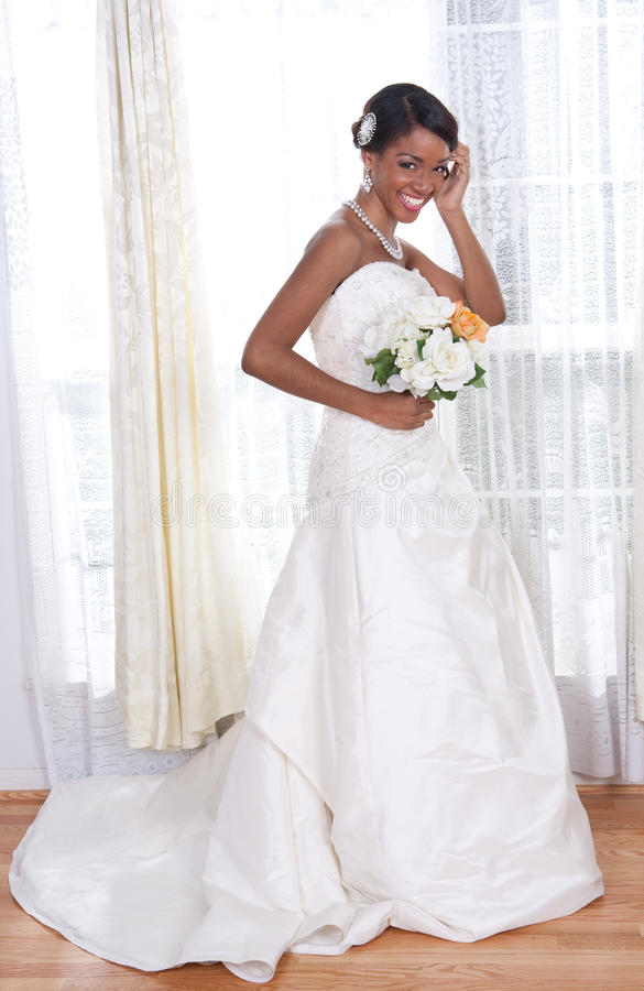 Beautiful Young Bride Standing By Window Stock Photography
