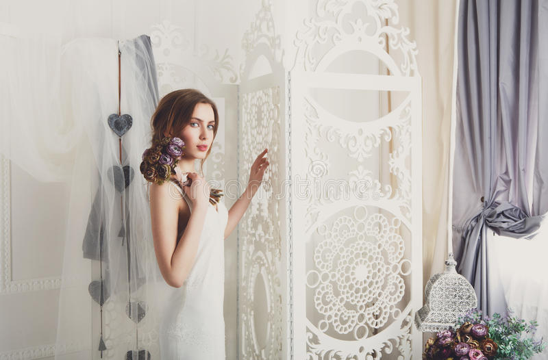 Beautiful young bride in vintage wedding dress stock photo
