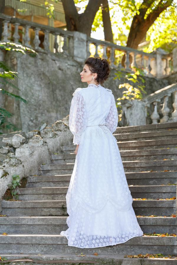 Beautiful Young Bride In Wedding Dress On The Steps. Stock Photo ...