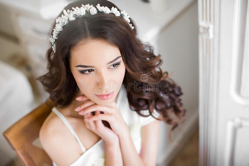 Beautiful young bride wedding makeup and hairstyle stock images
