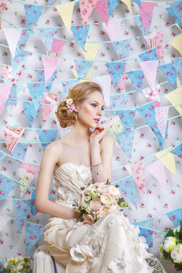 Beautiful young bride with wedding makeup and hairstyle in bedroom. Newlywed woman final preparation for wedding. Happy Bride waiting groom. Marriage Wedding stock photo