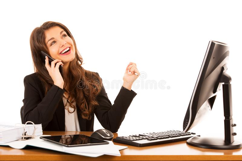 Beautiful young brunette business woman talks on smart phone over white background royalty free stock images