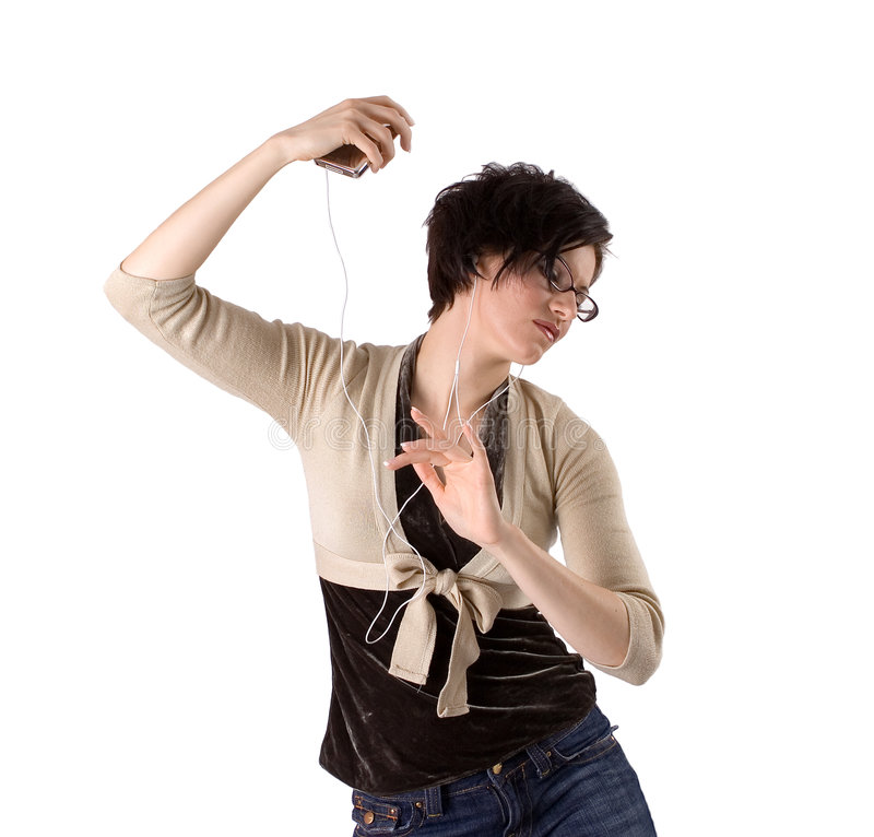 Beautiful young brunette dancing with MP3 player stock image