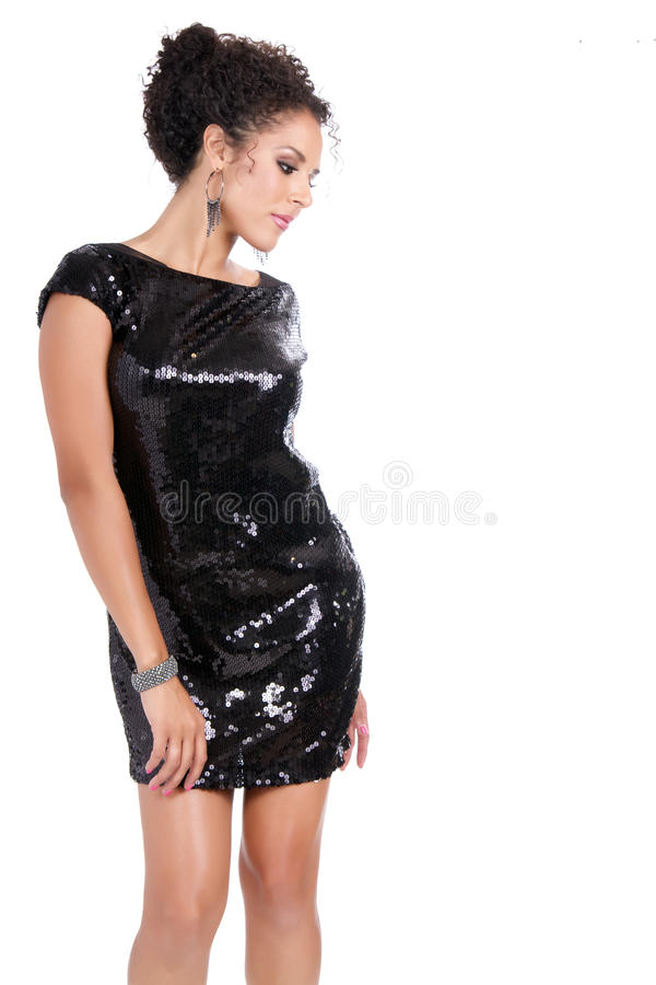 Beautiful young brunette female in black dress stock photo