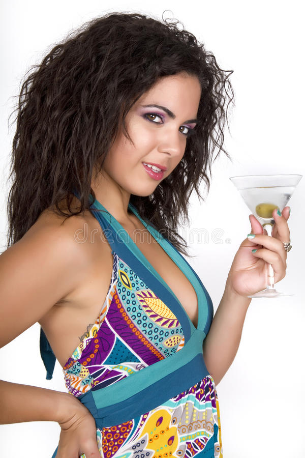 Beautiful young brunette female with a cocktail royalty free stock photography
