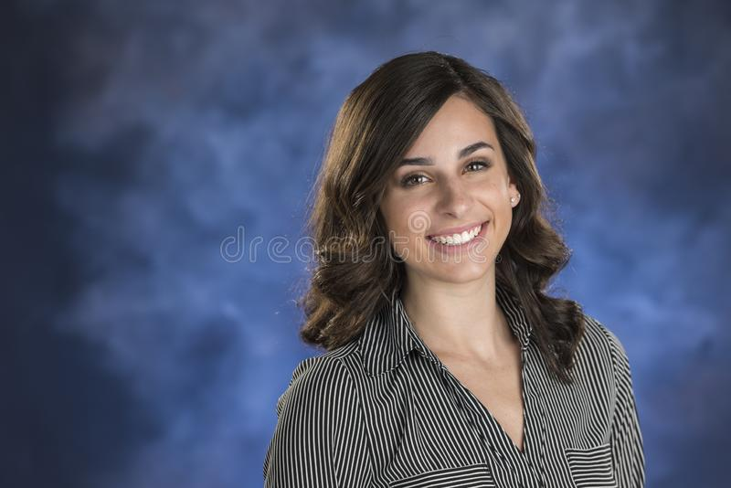 Beautiful Young Lady on Blue Background stock images