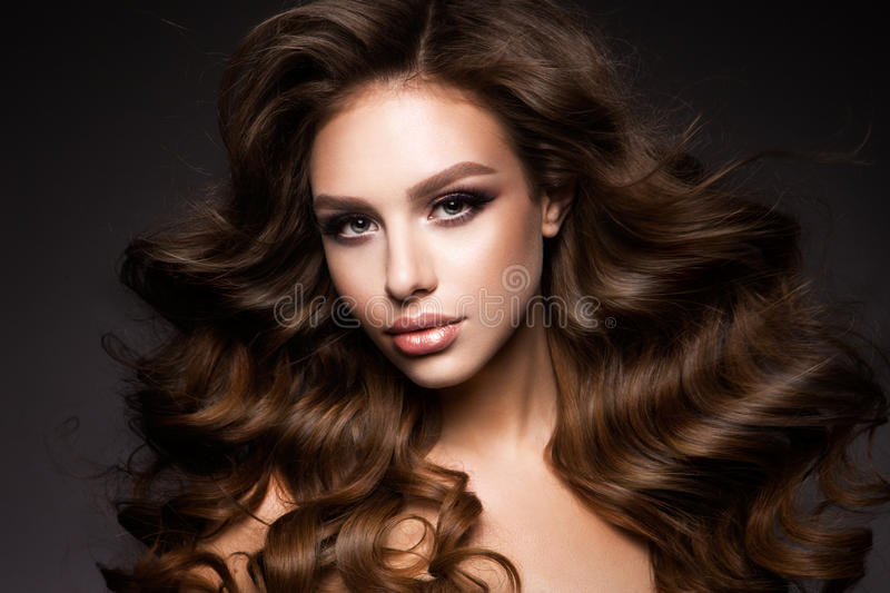 Beautiful young brunette with make-up royalty free stock photo