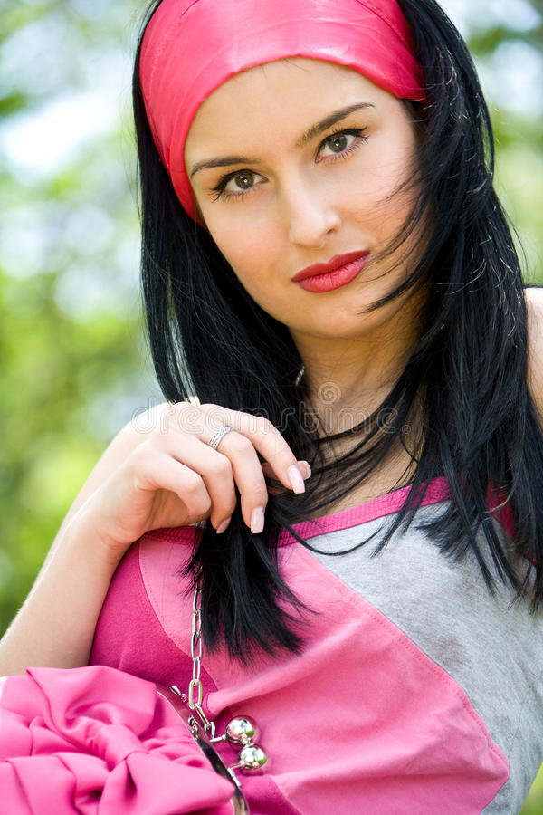 Download Beautiful Young Brunette With Pink Purse Stock Image - Image: 21075225