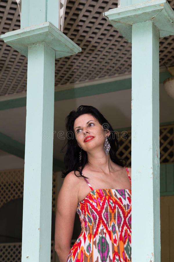 Beautiful young brunette in vintage hotel stock photos