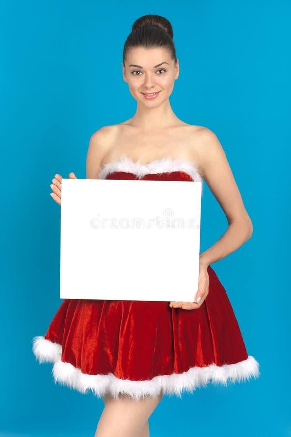 Beautiful young brunette woman as santa girl royalty free stock photo