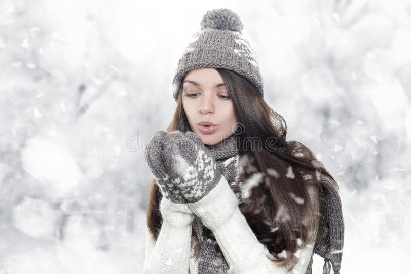 Download Beautiful Young Brunette Woman Heating Hands Royalty Free Stock Images - Image: 27801829
