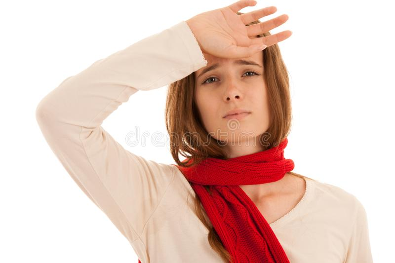 Beautiful young brunette woman holds her head as she has headache - illness stock photos
