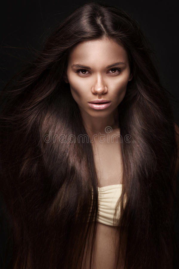 Beautiful young brunette woman with long straight hair stock images