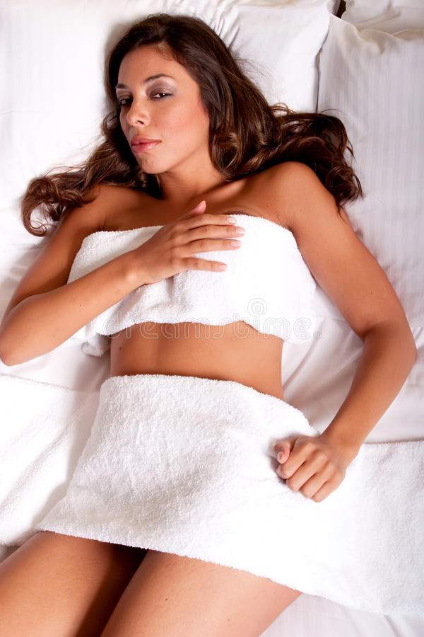 Download Beautiful Young Brunette Woman Relaxing On The Bed Stock Image - Image: 15091427