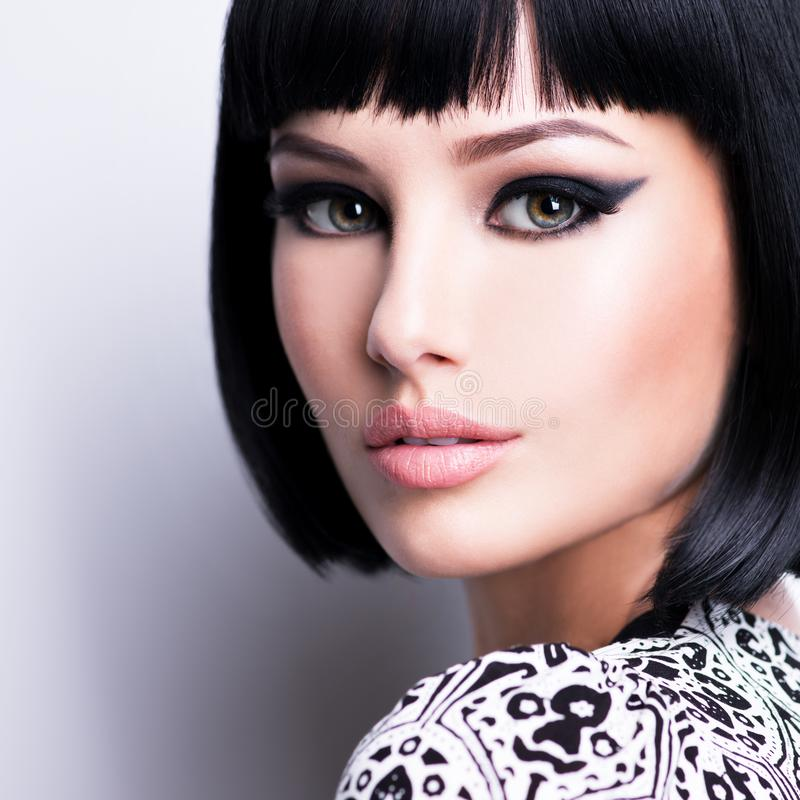 Beautiful young brunette woman with short hairstyle stock photo